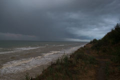 Storm front over water with wall of rain. In the centre Stock Photos