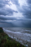 Storm front over water with wall of rain. In the centre Stock Images