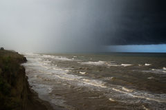 Storm front over water with wall of rain. In the centre Royalty Free Stock Photography
