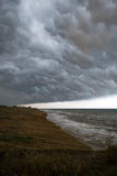 Storm front over water. With wall of rain in the centre Royalty Free Stock Image
