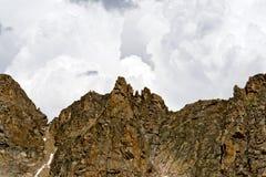 Storm Growing Behind Mountain Peaks Stock Images