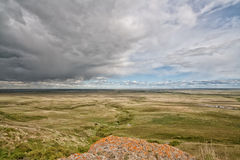 Storm at Head Smashed In Buffalo Jump. View from the historic head-smashed in buffalo jump as a storm comes in Stock Image