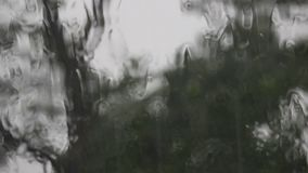 Storm and heavy rain. Stormy weather-rain and strong winds observed through the window of the house stock footage