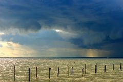 Storm is impending. Thunderstorm with dramatic and contrasts clouds Stock Photo