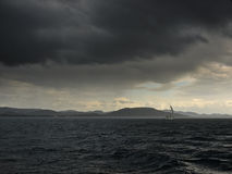 Storm. islands and sailing boat Royalty Free Stock Photography
