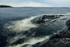 Storm on Ladoga lake. Rocks on island on Ladoga lake Royalty Free Stock Image
