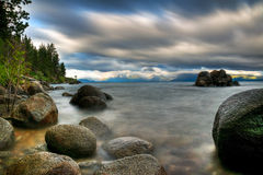 Storm on Lake Tahoe. A long exposure of a stormy day on the rocky shoreline of Lake Tahoe Royalty Free Stock Photo
