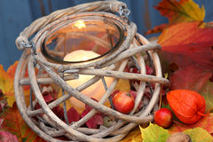 Storm lamp, autumn. Hand lantern with colored foliage Royalty Free Stock Photo