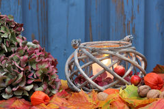Storm lamp, autumn. Hand lantern with colored foliage Stock Photos