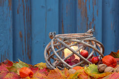 Storm lamp, autumn. Hand lantern with colored foliage, place for text Stock Photos