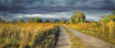 Before the Storm. Late autumn in the central part of Russia. A wooden house in the distance Stock Photo
