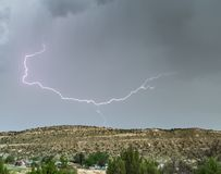Storm and Lightening Strike. A lightening strike and a storm taking place Stock Photo