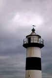 Storm lighthouse. Storm clouds forming over a lighthouse Royalty Free Stock Photo
