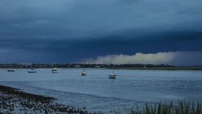 Storm and lighting over boats and water stock footage