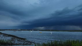 Storm and lighting over boats and water stock video footage