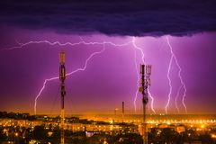 Storm lightning on the horizon over telephone towers. In Dnepr stock photography