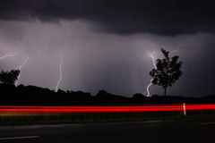 Storm and lightning at night I., on the road Royalty Free Stock Image