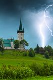 Storm with lightning in old village church Stock Image