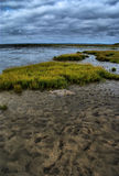 Storm at low tide. Upcoming storm in a  deserted beach at low tide Royalty Free Stock Photos