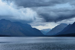 Storm in the Mountains at McDonald lake in Glacier National Park after sunset Stock Photos