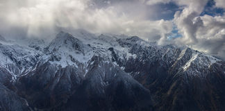 Storm in the mountains. Panoramic view on mountains in winter Stock Images