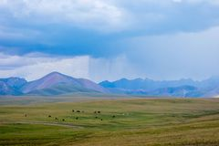 Storm in the mountains of Song Kul. Storm over the mountains next to Song Kul lake, Kyrgyzstan Royalty Free Stock Image