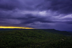 Shelf Cloud Storm Moving Over Ozark Valley. Storm moving over a lush valley covering the sunset in the distance stock photos