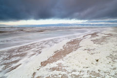 Storm on North sea with a lot of foam Royalty Free Stock Photo