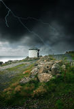 Storm by the ocean. Lightning strike and strong wind blowing by the ocean in Land's End, UK Stock Photos