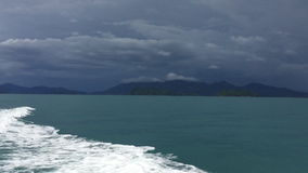 Before the storm in the ocean. Storm clouds over the islands in the ocean stock video footage
