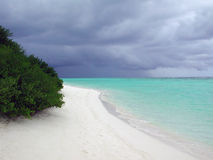 Storm Offshore. Beach in the Maldives, with a storm brewing offshore Stock Image