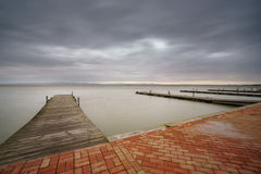 Storm over Albufera with pier, perspective, Valencia Royalty Free Stock Photo