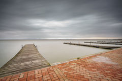 Storm over Albufera with pier, perspective, Valencia Royalty Free Stock Photos