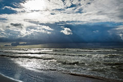 Storm over baltic sea with sunbeam Royalty Free Stock Images