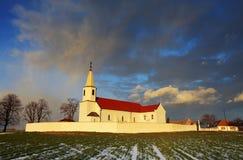 Storm over catholic church Stock Photo
