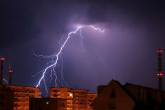 Storm over city. View of a thunderbolt during a storm over city Stock Photo