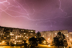 Storm over city stock photography