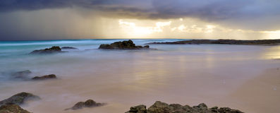 Storm over Deadman's Beach. A storm over Deadman's Beach at Point Lookout, North Stradbroke Island off Queensland, Australia Stock Photo