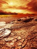 Storm over dried cracked soil Royalty Free Stock Photos