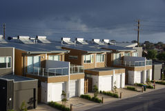 Storm Over Eco Apartments. A row of modern eco style apartments, with a storm brewing overhead. Adelaide, South Australia royalty free stock photos