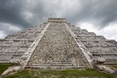 Storm over El Castillo temple at Chichen Itza. Rain storm over main temple at Chichen Itza one of the new seven wonders of the world Royalty Free Stock Photos
