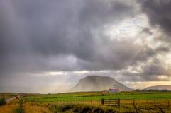 Storm over farm stock photo