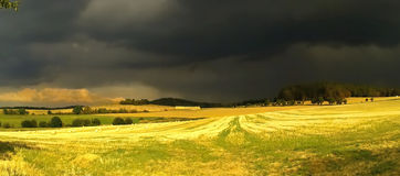 Storm. Over the field and landscape Royalty Free Stock Image
