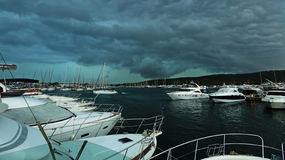 The storm over the harbor with yachts Stock Photo