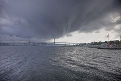 Storm over harbour bridge Royalty Free Stock Photos