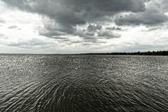 Storm over the lake Royalty Free Stock Photo
