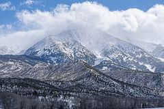 Storm over Mount Sopris Peak. Mount Sopris during a snow storm at the top of the peak Royalty Free Stock Images