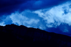 Storm over mountain Stock Images