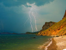 Storm over a mountain Kara-Dag in Crimea. Lightning and rain over the Black sea coast of Crimea, near Koktebel Stock Photos