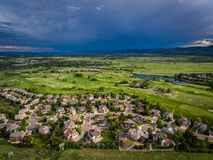 Storm over Neighborhood. Storm clouds move in over a golf course and neighborhood in Lakewood, outside of Denver, Colorado royalty free stock photography